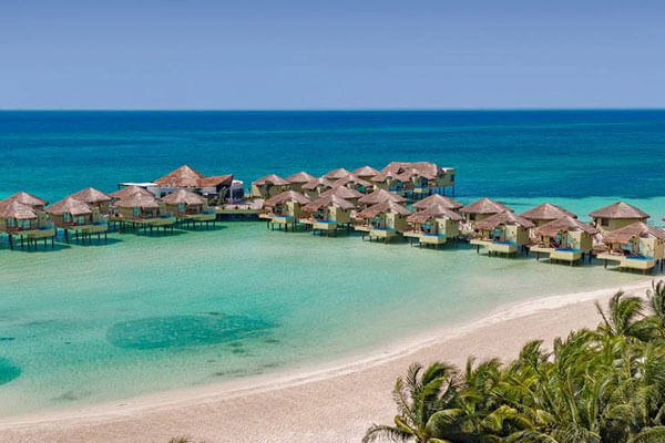 BOOK NOW with Travel Savvi - Wedding Destinations and Large Group Travel – The Palafitos-Overwater Bungalows at El Dorado Maroma